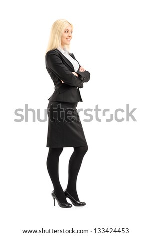 Full length portrait of a professional woman standing with arms crossed, isolated on white background - stock photo