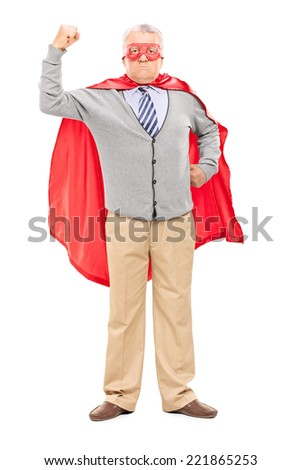 Full length portrait of a proud mature man in superhero costume throwing his fist in the air isolated on white background - stock photo