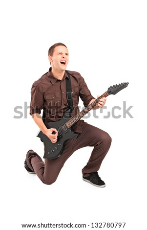 Full length portrait of a rock star playing a guitar isolated against white background - stock photo