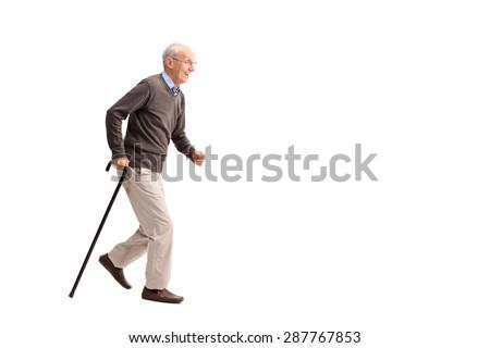Full length portrait of a rushing senior walking fast isolated on white background - stock photo