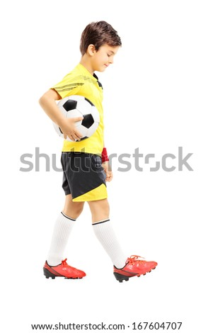 Full length portrait of a sad kid in sportswear posing with a soccer ball isolated on white background - stock photo