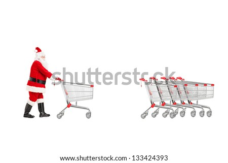 Full length portrait of a Santa Claus returning an empty shopping cart isolated on white background - stock photo