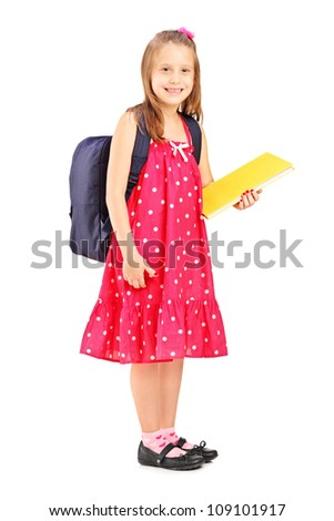 Full length portrait of a school girl holding notebook, isolated on white background - stock photo
