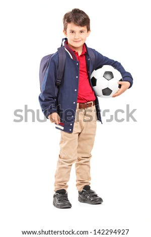 Full length portrait of a schoolboy holding a soccer ball, isolated on white background - stock photo