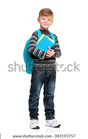 Full length portrait of a schoolboy with backpack and books, isolated on white background - stock photo