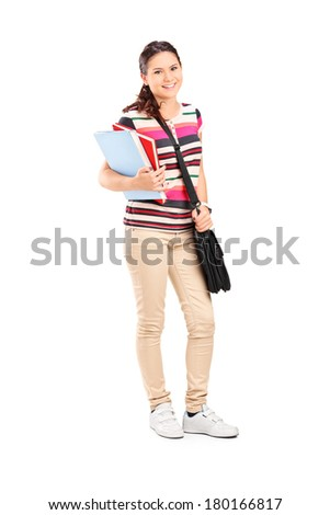 Full length portrait of a schoolgirl holding notebooks isolated on white background - stock photo