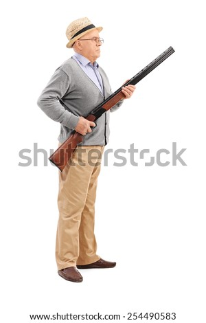 Full length portrait of a senior gentleman holding a rifle isolated on white background - stock photo