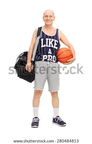 Full length portrait of a senior man in sportswear holding a basketball and looking at the camera isolated on white background - stock photo