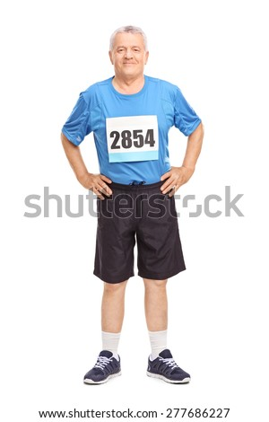 Full length portrait of a senior man in sportswear with a race number on his chest looking at the camera isolated on white background - stock photo