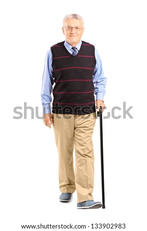 Full length portrait of a senior man walking with a cane, isolated on white background - stock photo