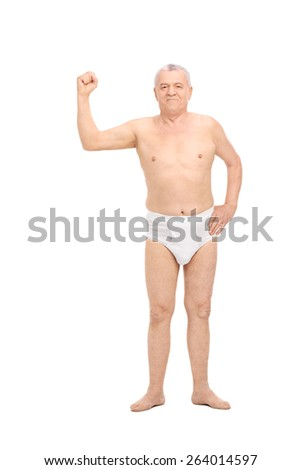 Full length portrait of a senior man wearing nothing but underwear and showing his bicep isolated on white background  - stock photo
