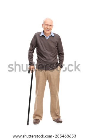 Full length portrait of a senior man with a cane smiling and posing isolated on white background - stock photo