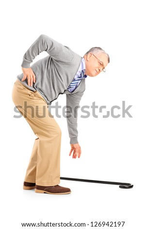 Full length portrait of a senior man with back pain trying to pick up a cane isolated on white background - stock photo