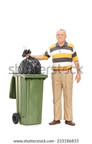 Full length portrait of a senior throwing out the trash isolated on white background - stock photo