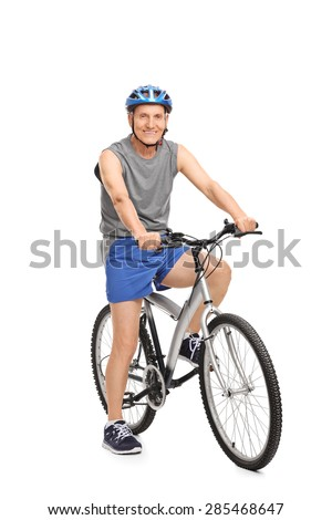 Full length portrait of a senior with a blue helmet posing seated on a bicycle isolated on white background - stock photo