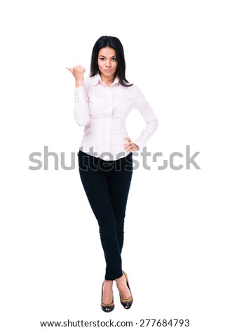 Full length portrait of a serious businesswoman pointing finger away isolated on a white background. Looking at camera - stock photo