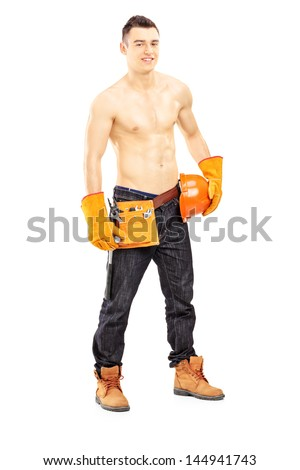 Full length portrait of a shirtless muscular male construction worker isolated on white background - stock photo
