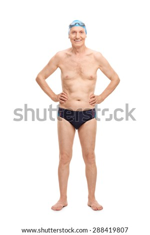 Full length portrait of a shirtless senior in black swim trunks and blue swimming cap looking at the camera and smiling isolated on white background - stock photo