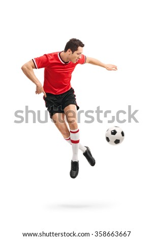 Full length portrait of a skillful football player performing a rainbow flick shot in mid-air isolated on white background - stock photo