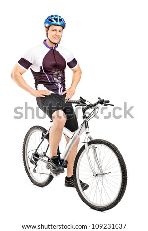 Full length portrait of a smiling bicyclist posing on a bicycle isolated against white background - stock photo