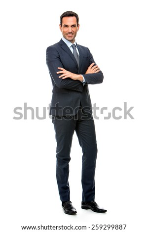Full length portrait of a smiling businessman looking at camera with crossed arms - stock photo
