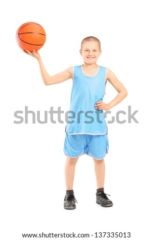 Full length portrait of a smiling child holding a basketball isolated on white background - stock photo