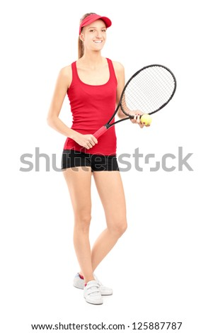 Full length portrait of a smiling female holding a tennis racket and a ball isolated on white background - stock photo