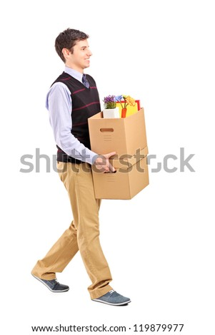 Full length portrait of a smiling male walking with boxes, moving into a new home isolated on white background - stock photo