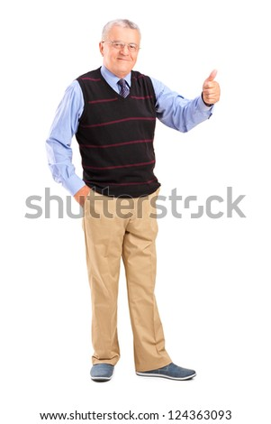 Full length portrait of a smiling mature man giving a thumb up isolated on white background - stock photo