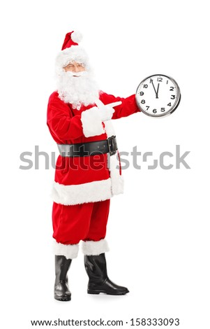 Full length portrait of a smiling Santa Claus pointing on a clock isolated on white background - stock photo
