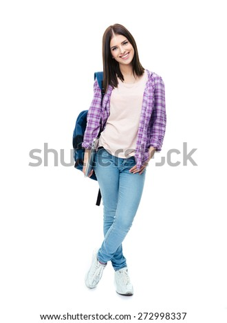 Full length portrait of a smiling young woman standing with backpack and laptop. Looking at camera - stock photo