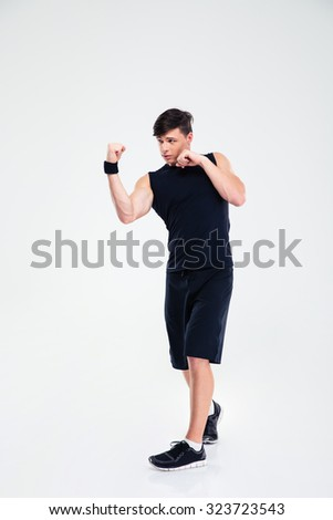 Full length portrait of a sports man boxing isolated on a white background - stock photo