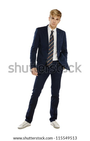 Full length portrait of a stylish young man standing with hand in pocket over white background - stock photo