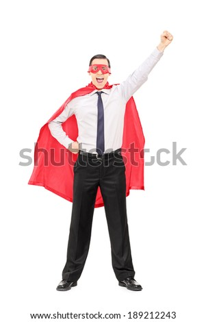 Full length portrait of a superhero with raised fist isolated on white background - stock photo