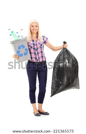 Full length portrait of a woman holding a recycle bin and a trash bag isolated on white background - stock photo