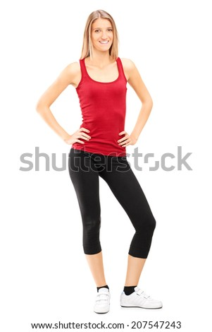 Full length portrait of a woman in sportswear posing isolated on white background - stock photo