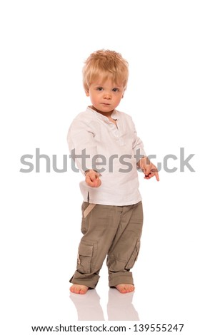 Full length portrait of a young boy. Isolated on white background - stock photo