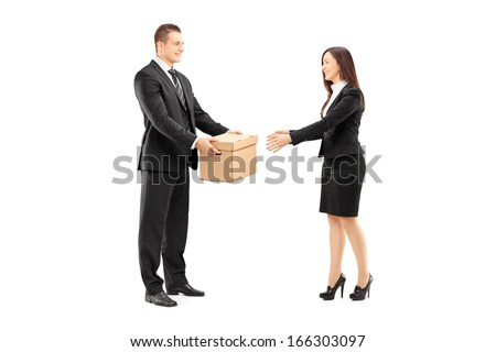Full length portrait of a young businessman giving a box to his female colleague, isolated on white background - stock photo