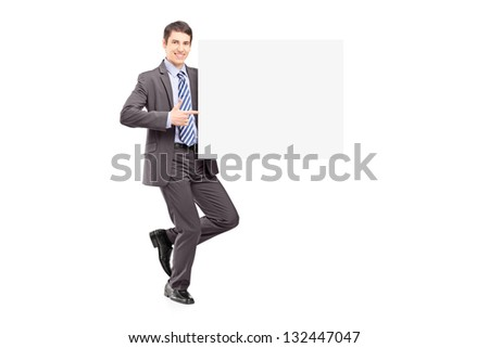 Full length portrait of a young businessman holding a blank panel isolated on white background - stock photo