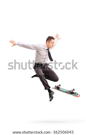 Full length portrait of a young businessman performing tricks with a skateboard shot in mid-air isolated on white background - stock photo
