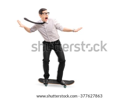 Full length portrait of a young businessman riding a skateboard fast isolated on white background - stock photo