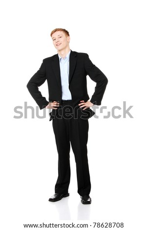 Full length portrait of a young businessman standing - stock photo