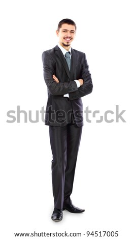 Full length portrait of a young businessman standing with his hands holding - stock photo