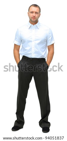Full length portrait of a young businessman standing with his hands in the pockets. - stock photo