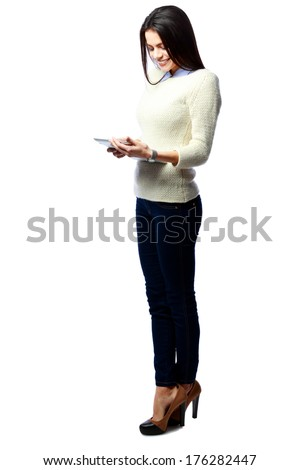 Full-length portrait of a young businesswoman holding tablet computer isolated on a white background - stock photo