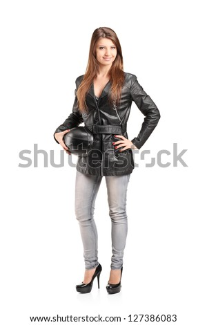 Full length portrait of a young female biker in a leather jacket isolated on white background - stock photo