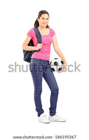 Full length portrait of a young girl holding a football isolated on white background - stock photo