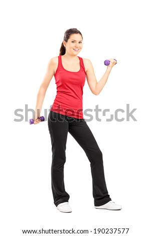 Full length portrait of a young girl lifting dumbbells isolated on white background - stock photo
