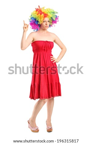Full length portrait of a young girl with wig pointing up with finger isolated on white background - stock photo