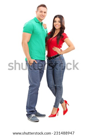 Full length portrait of a young handsome couple posing isolated on white background - stock photo